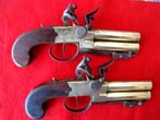 click to view detailed description of A fine pair of British flintlock pistols with brass over and under barrels with folding bayonets by L.Samuel of Liverpool circa 1780-1800.