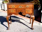 click to view detailed description of An English George I period walnut and oak Dressing Table circa 1720