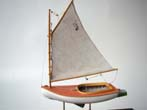 click to view detailed description of An exceptionally fine scratch built model of a circa 1921 Beetle Catboat in 1:48 scale