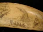 click to view detailed description of A late 19th or early 20th century Sperm whale tooth with whaling scene and the Whaling Bark 'Florence.'