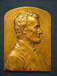 click to view detailed description of A beautiful vintage bronze plaque depicting Abraham Lincoln sculpted by Luini Costanzo circa 1920