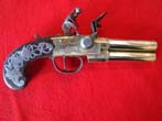 click to view detailed description of A fine late 18th century English tap action over/under brass barreled flintlock pistol