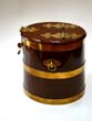click to view detailed description of A magnificent 19th century miniature brass mounted walnut Royal Navy rum barrel circa 1860