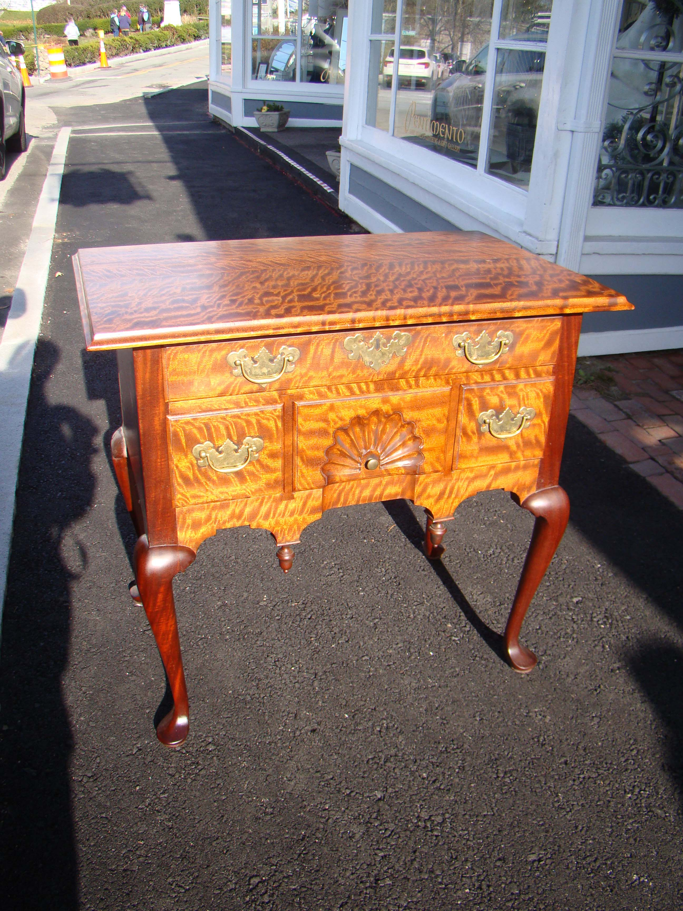 click to view detailed description of An exceptionally beautiful contemporary Queen Anne style lowboy