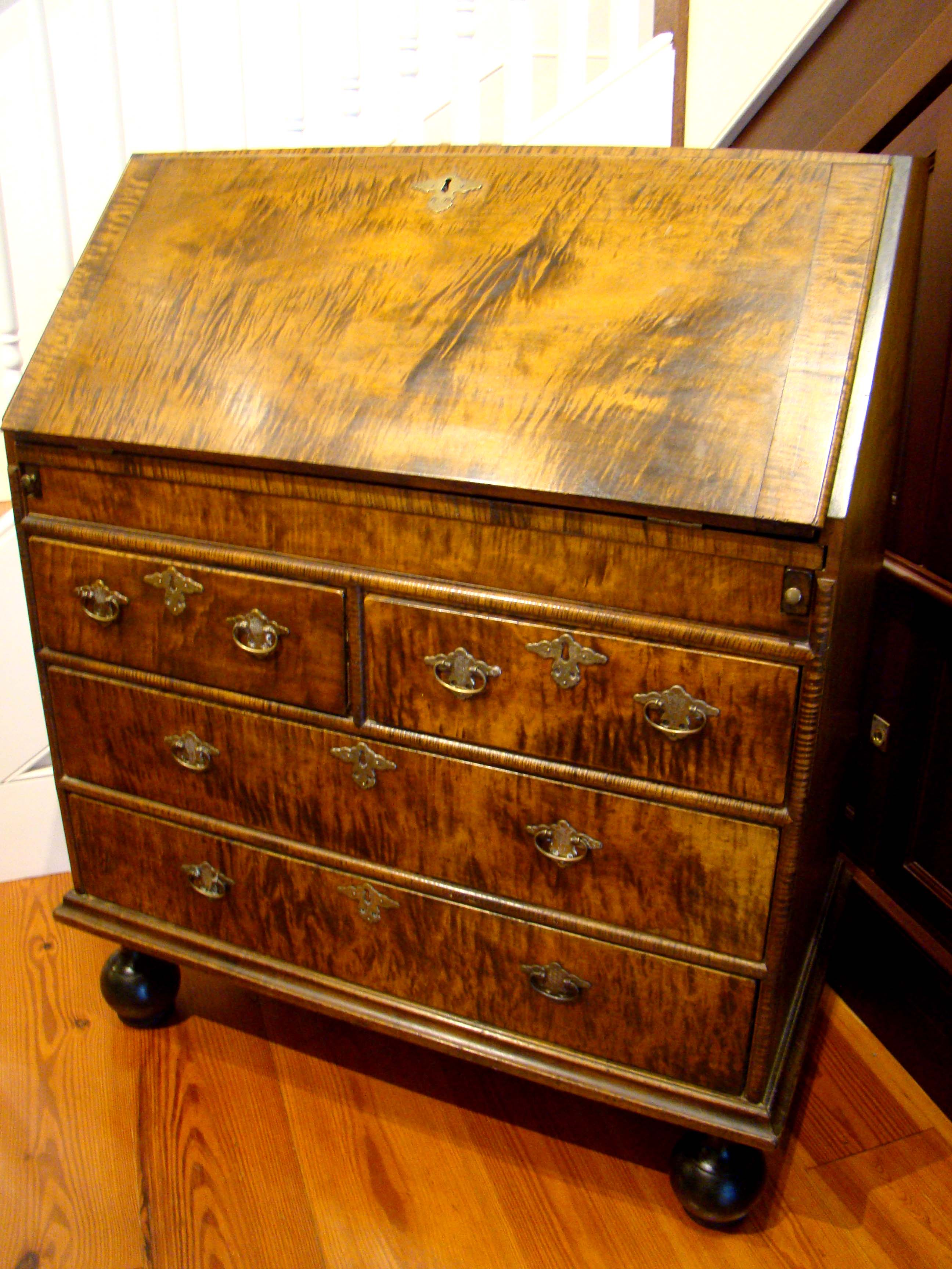 click to view detailed description of An exceptionally fine contemporary William & Mary style tiger maple slant lid desk