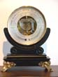 click to view detailed description of A fine 19th century Aneroid Barometer on a custom made black lacquered stand with gilt ormolu feet circa 1850.
