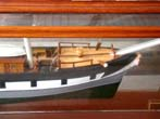 click to view detailed description of A cased model of the OUTLAPA, a three-masted ship built at Sunderland, England in 1869.