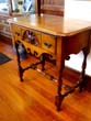 click to view detailed description of A RARE table made from wood removed from the Orlop deck of