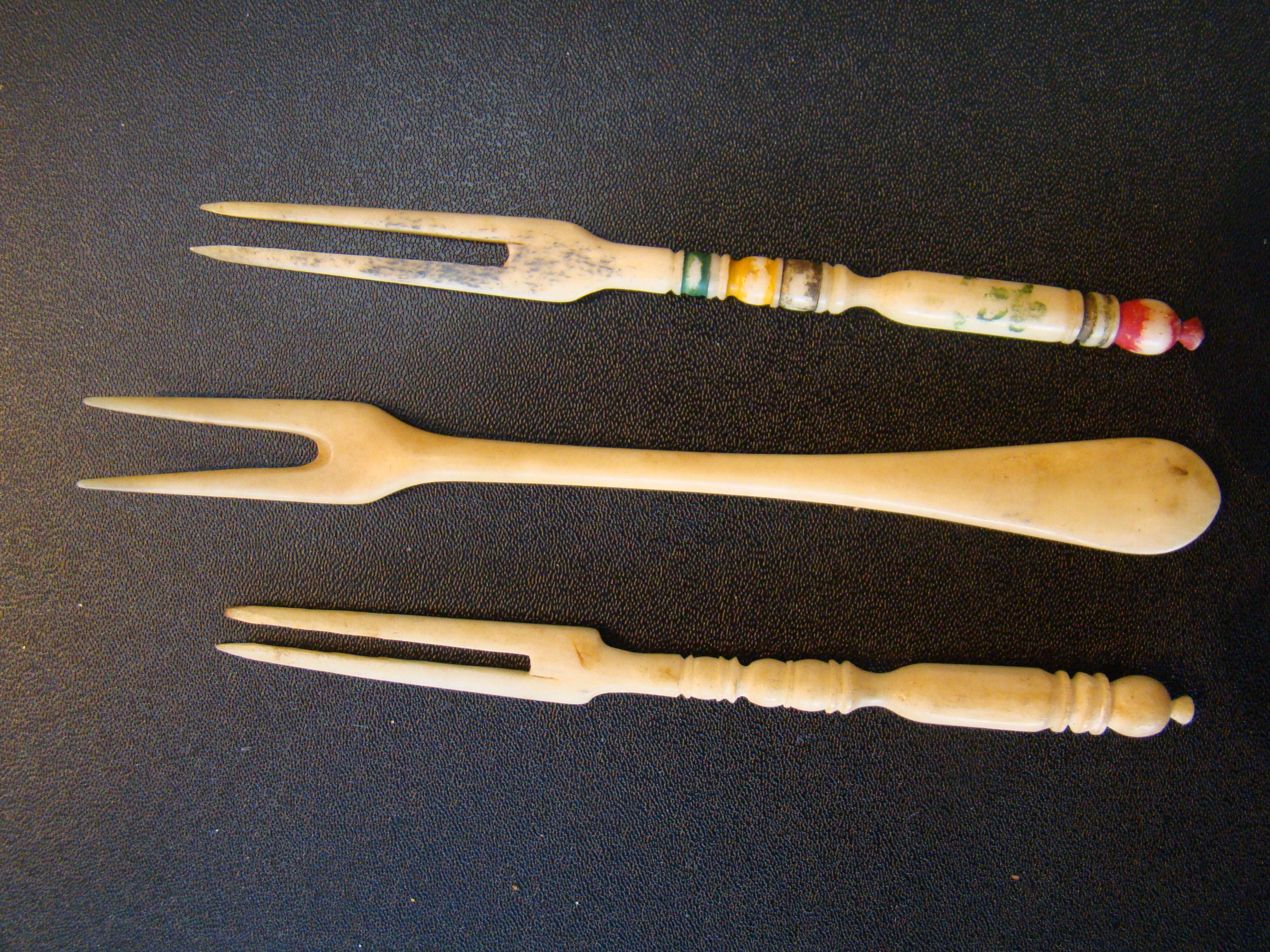 click to view detailed description of A group of three 19th century whalebone forks