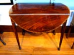 click to view detailed description of A magnificent late 18th or early 19th century mahogany HEPPLEWHITE Pembroke Table