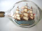 click to view detailed description of A model of the USS Constitution in a bottle made circa 1960-1970