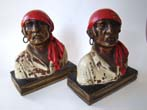 click to view detailed description of A pair of Pirate Head bookends designed by Paul Herzel in 1928