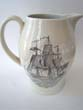 click to view detailed description of A black transferware Liverpool pitcher made for the Nantucket Historical Association by Mottahedeh