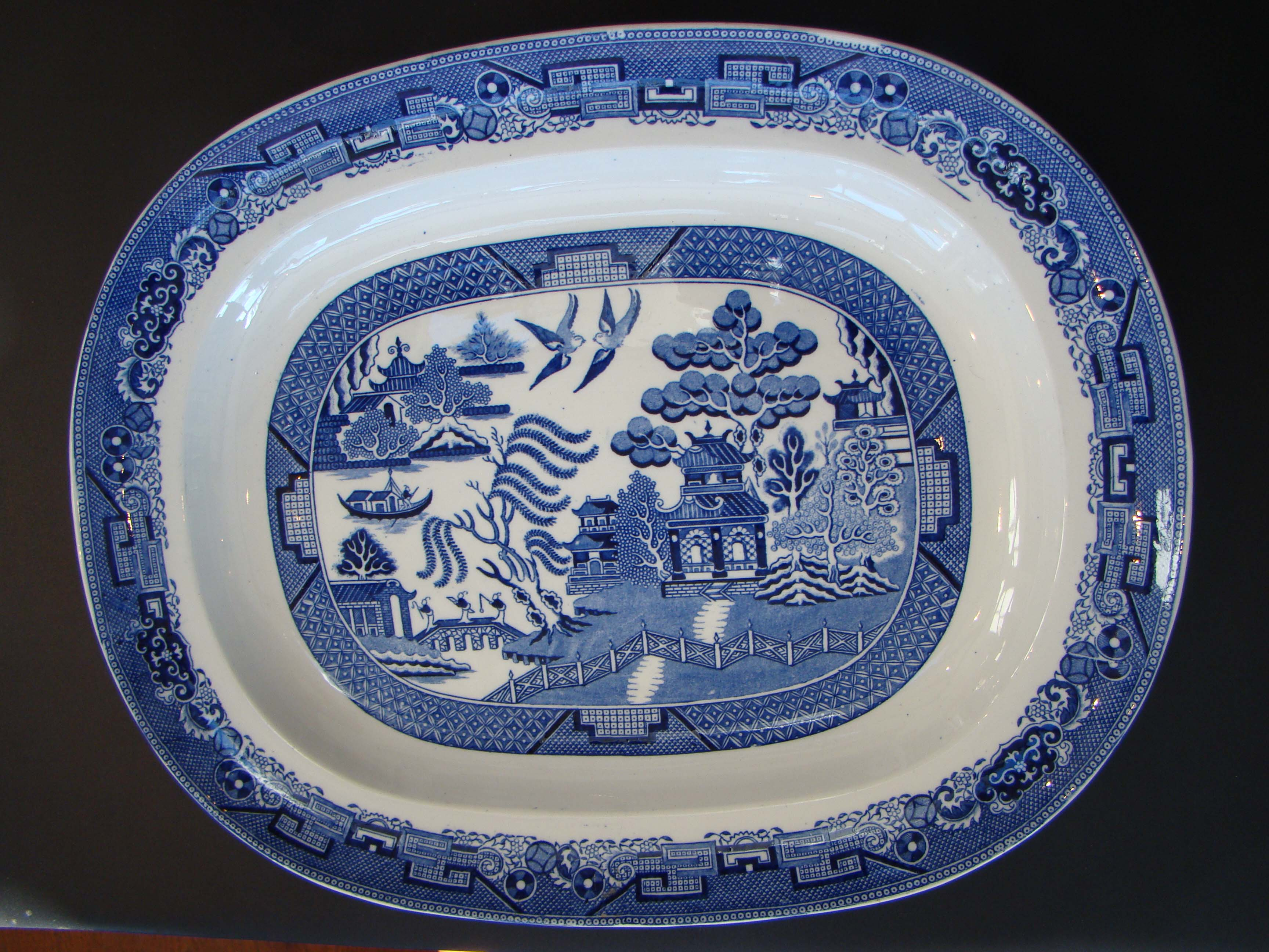 click to view detailed description of An exceptionally large and heavy 19th century Blue Willow serving platter
