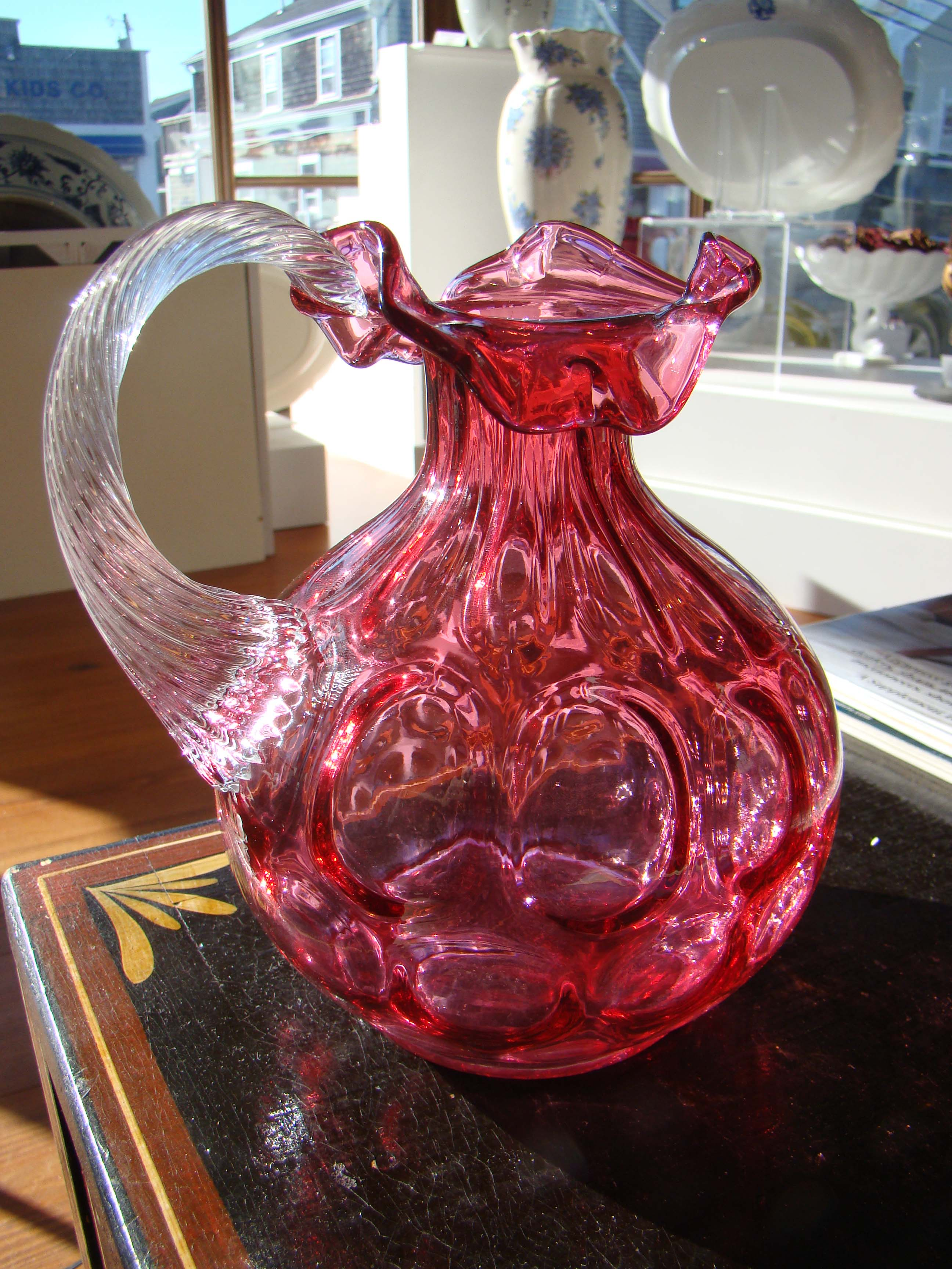 click to view detailed description of A beautiful vintage signed FENTON cranberry glass jug