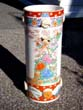 click to view detailed description of A late 19th century Japanese polycrome porcelain umbrella stand