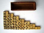 click to view detailed description of A set of Civil War era bone and ebony dominoes circa 1865