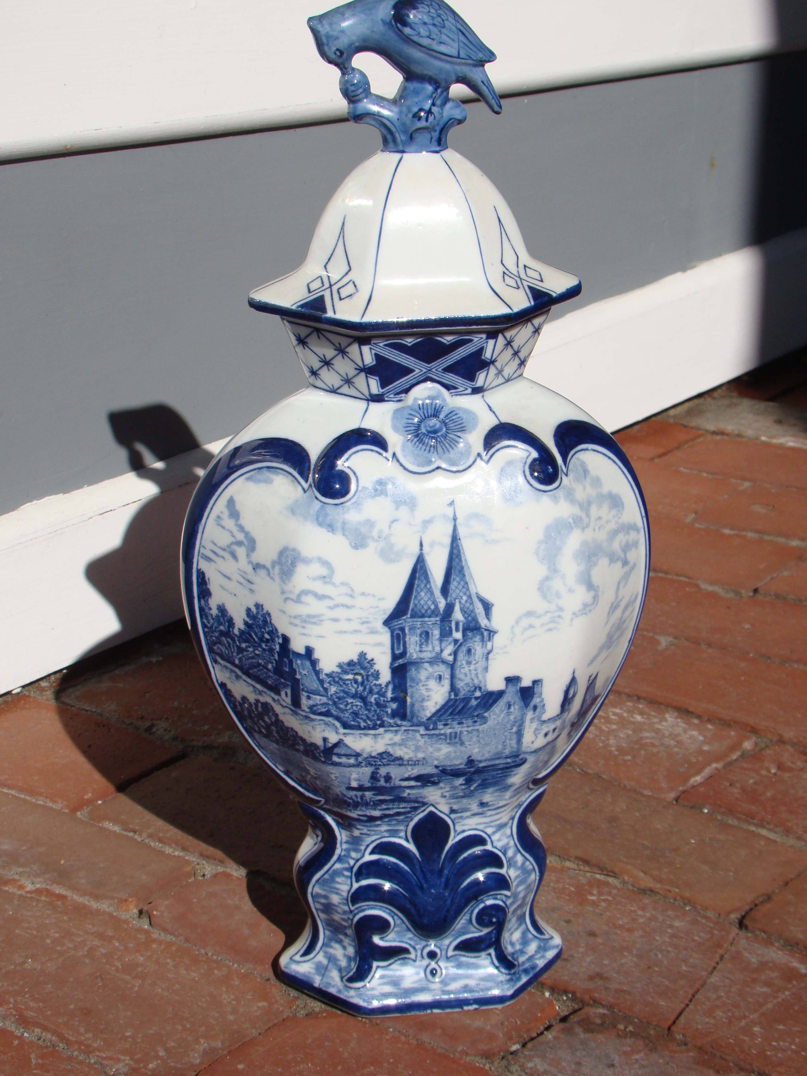 click to view detailed description of A fine vintage hand painted Dutch Delft covered jar with partridge finial