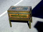 click to view detailed description of A 19th Century Painted China Trade Trunk on a Later Matching Stand Circa 1830.