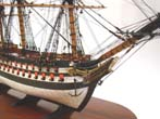 click to view detailed description of A fantastic Prisoner-of-War STYLE Bone and wood model,circa 1920, of a late 18th century 74 gun English Ship-of-the line