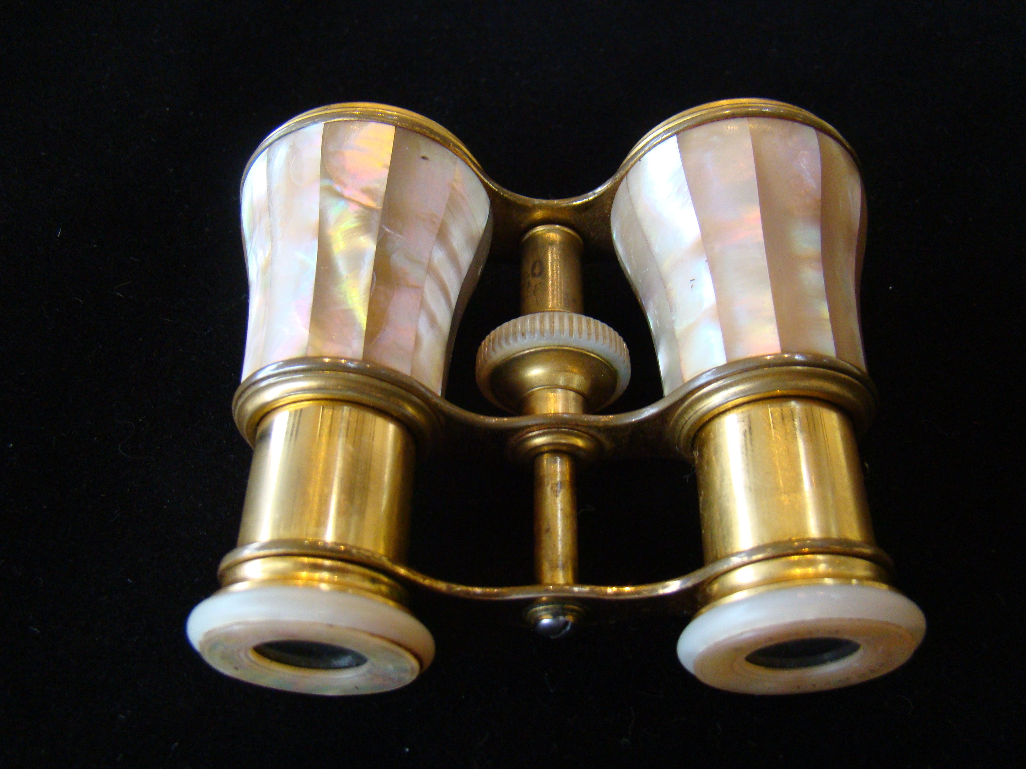click to view detailed description of A fine pair of French opera glasses made by Lemaire of Paris and retailed by Alexander Stowell of Boston circa 1890