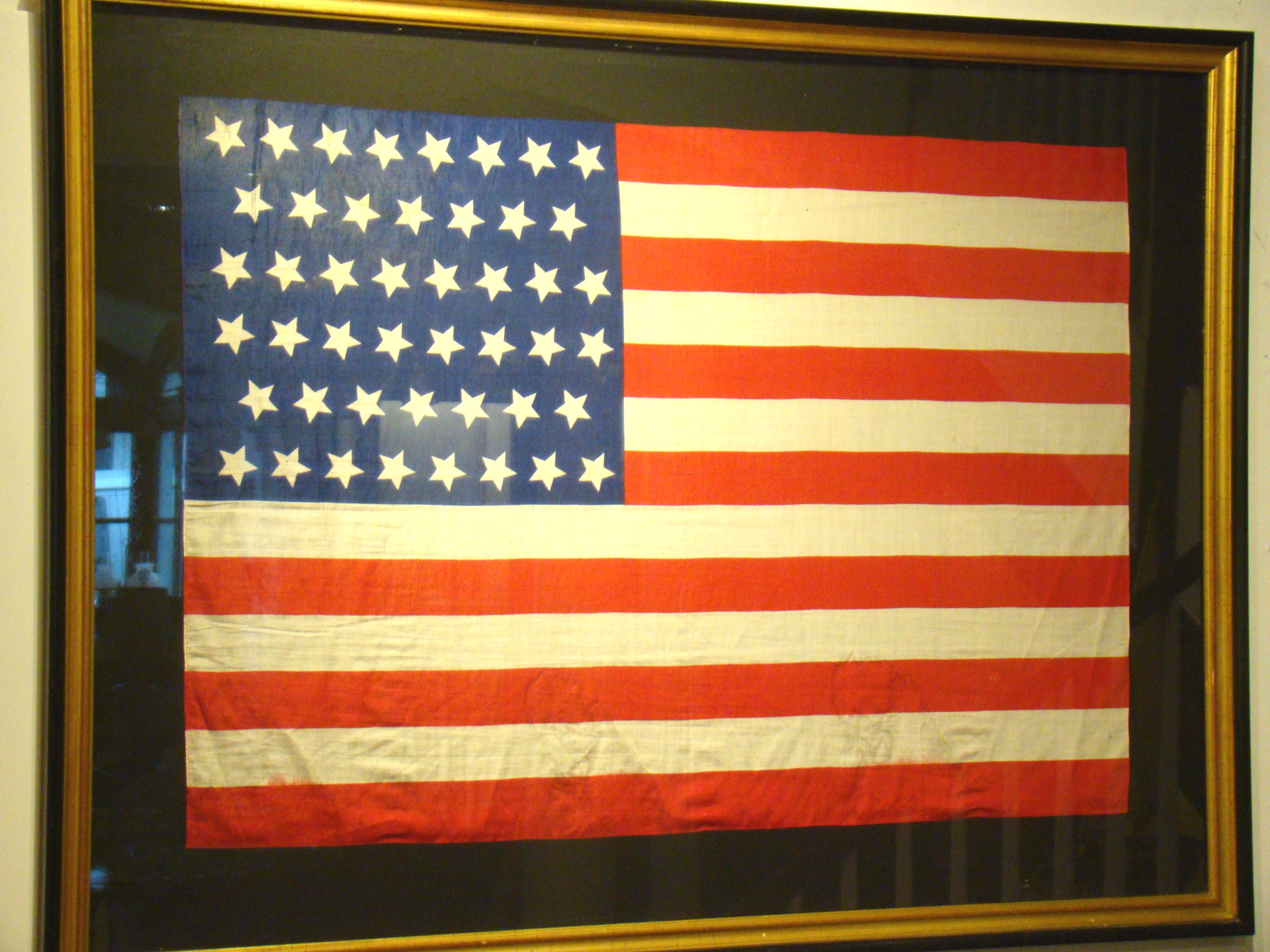 click to view detailed description of A fine 46 star American parade flag made to celebrate Oklahoma joining the Union on July 4, 1908