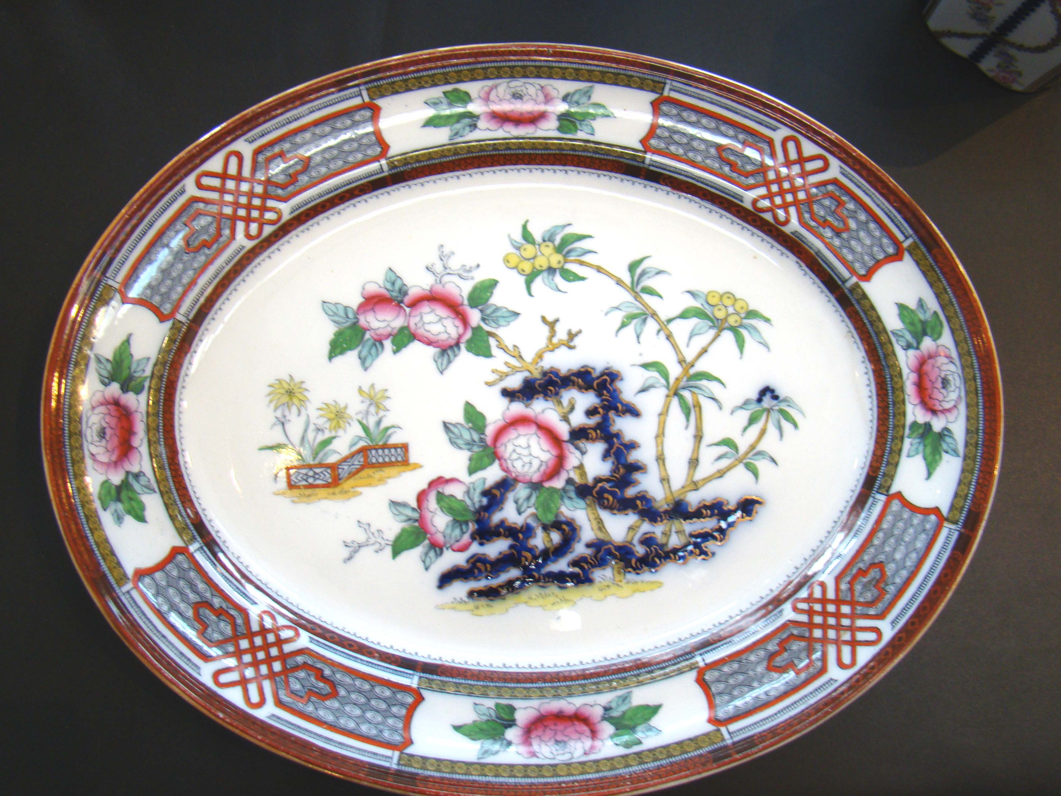 click to view detailed description of An attractive English Staffordshire serving platter circa 1875 in the Chinese peony pattern.