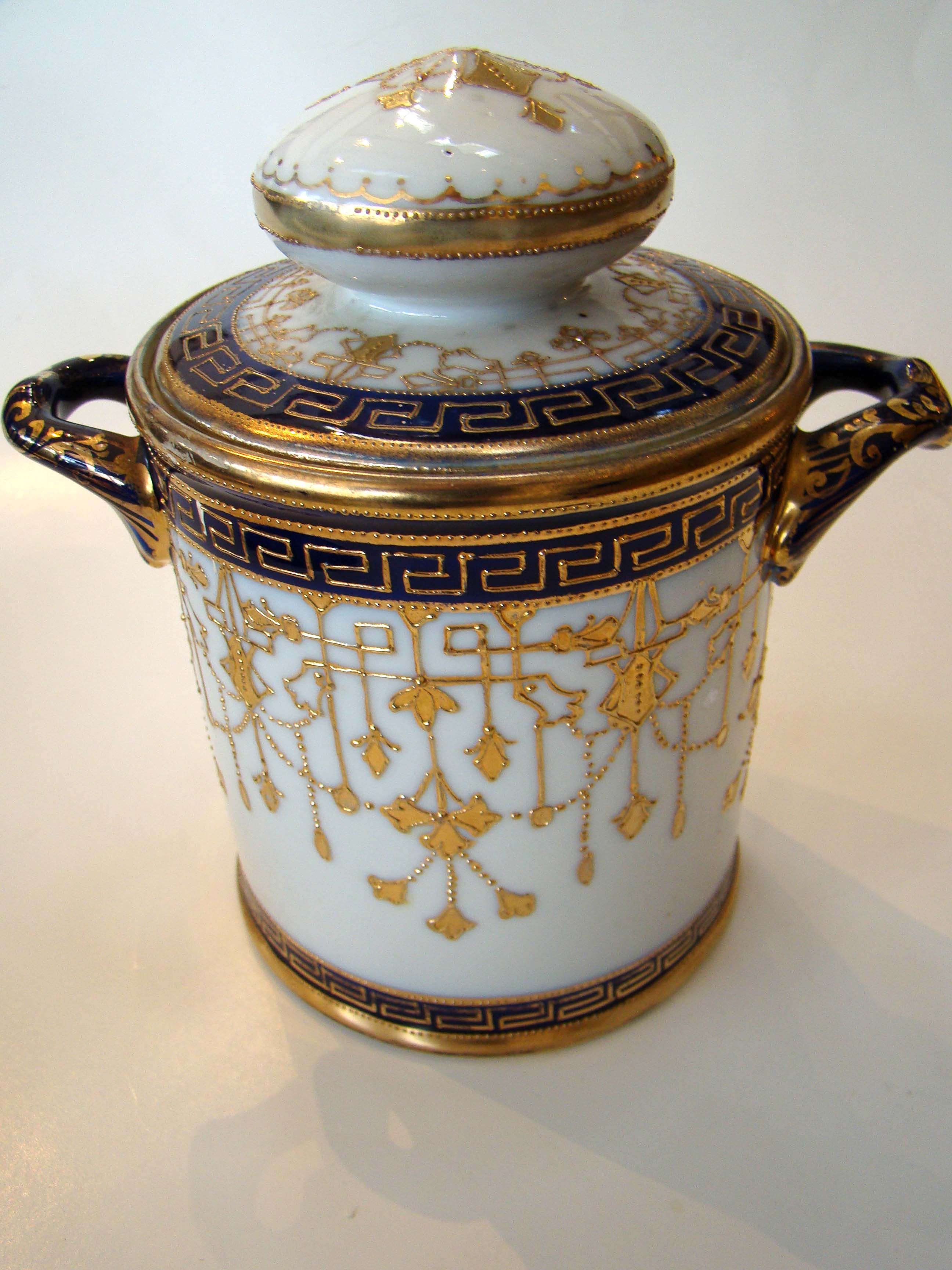 click to view detailed description of A visually stunning hand painted NIPPON covered jar circa 1900