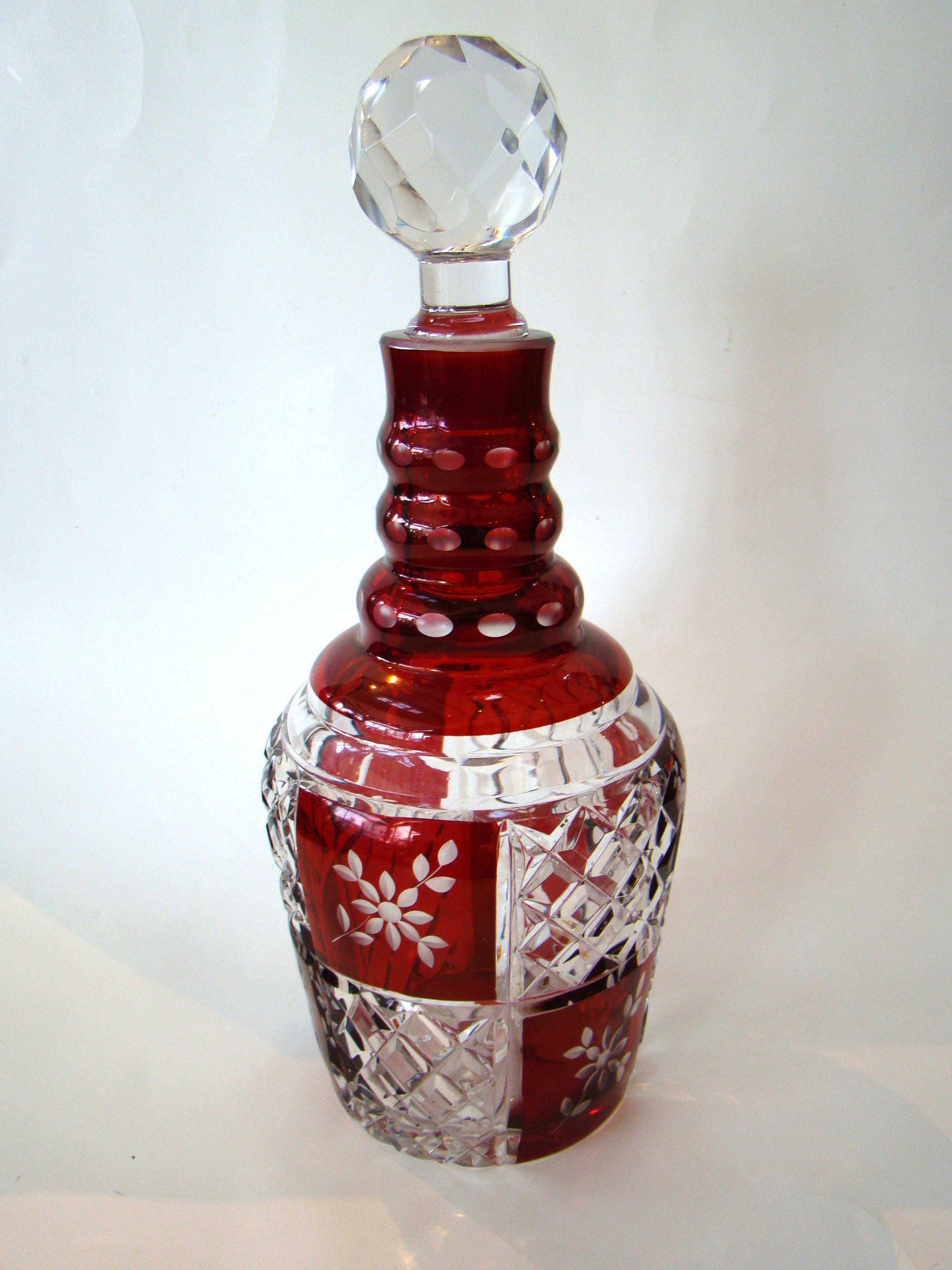 click to view detailed description of A FABULOUS vintage cranberry cut crystal decanter circa 1900-1920