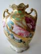 click to view detailed description of An extremely attractive two handled vase, possibly by Nippon, circa 1900