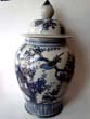 click to view detailed description of An attractive and large Chinese covered jar with gold highlights, 20th century.