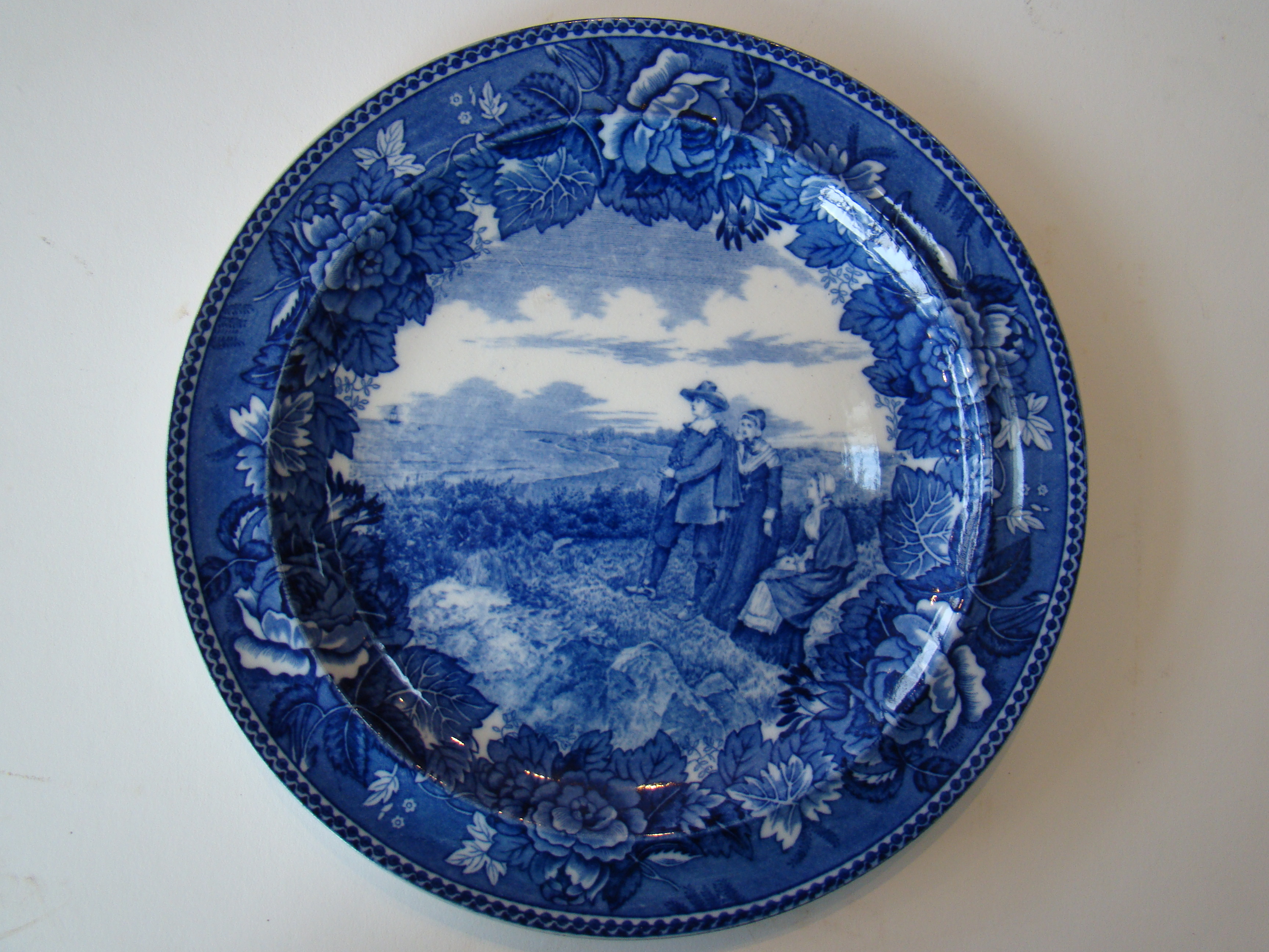 click to view detailed description of A fine late 19th century Wedgwood souvenir plate depicting the Courtship of Myles Standish--The Pilgrim Exiles.