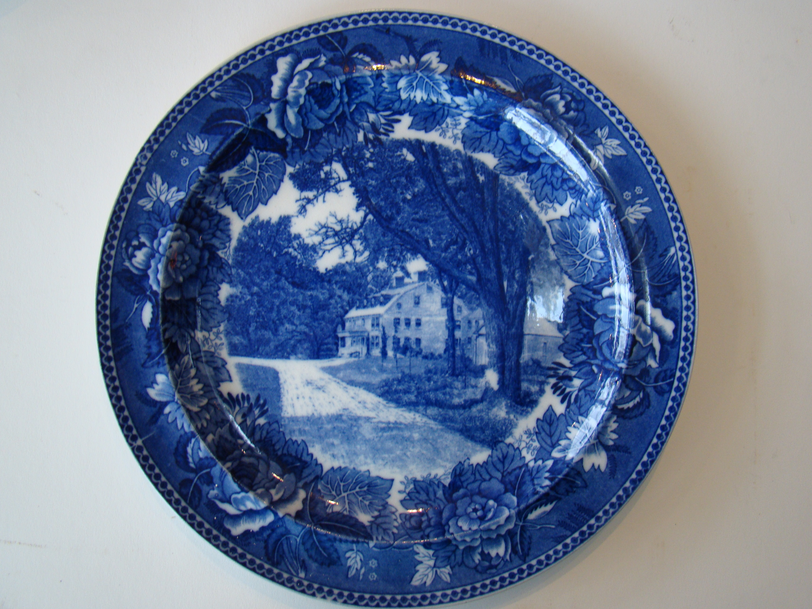 click to view detailed description of A fine late 19th century Wedgwood souvenir plate depicting Longfellows Wayside Inn in Sudbury, Mass