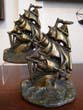 click to view detailed description of A pair of U.S.S. Constitution bookends by Greenblat Studios of Boston circa 1926