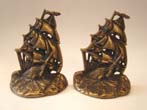 click to view detailed description of A pair of U.S. Frigate Constitution bookends by Greenblat Studios, Boston, 1925