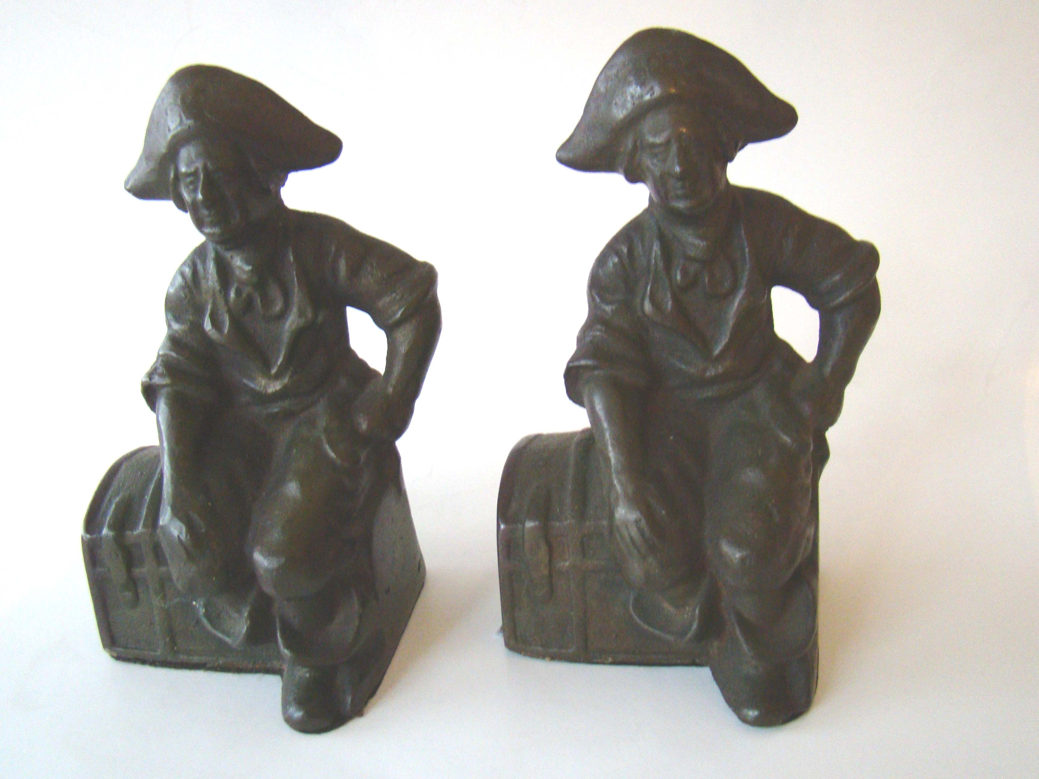 click to view detailed description of A charming pair of antique bookends depicting a pirate sitting on a treasure chest circa 1910-1920