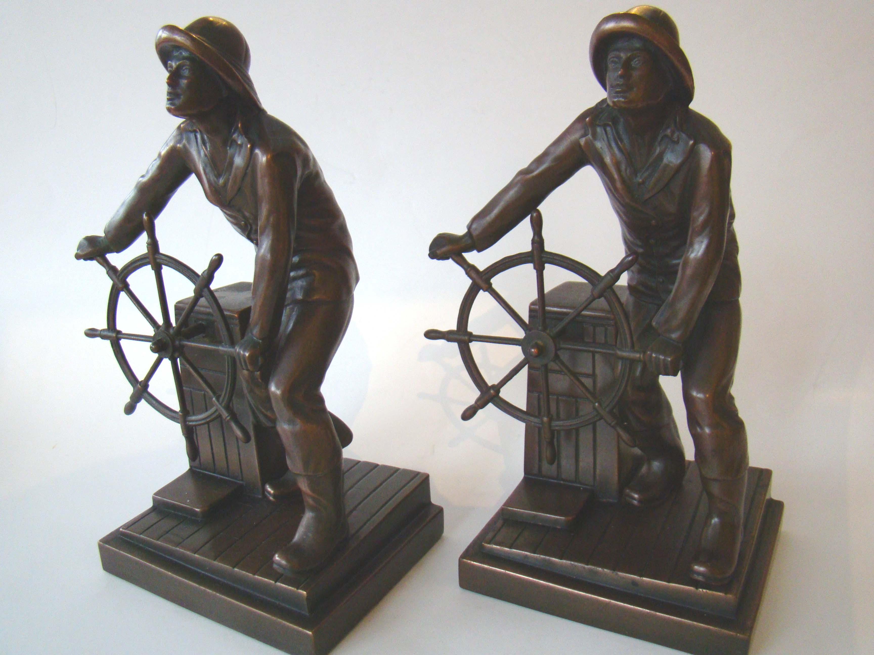 click to view detailed description of The finest pair of 'Gloucester fisherman' bookends circa 1930 that I have ever seen!!