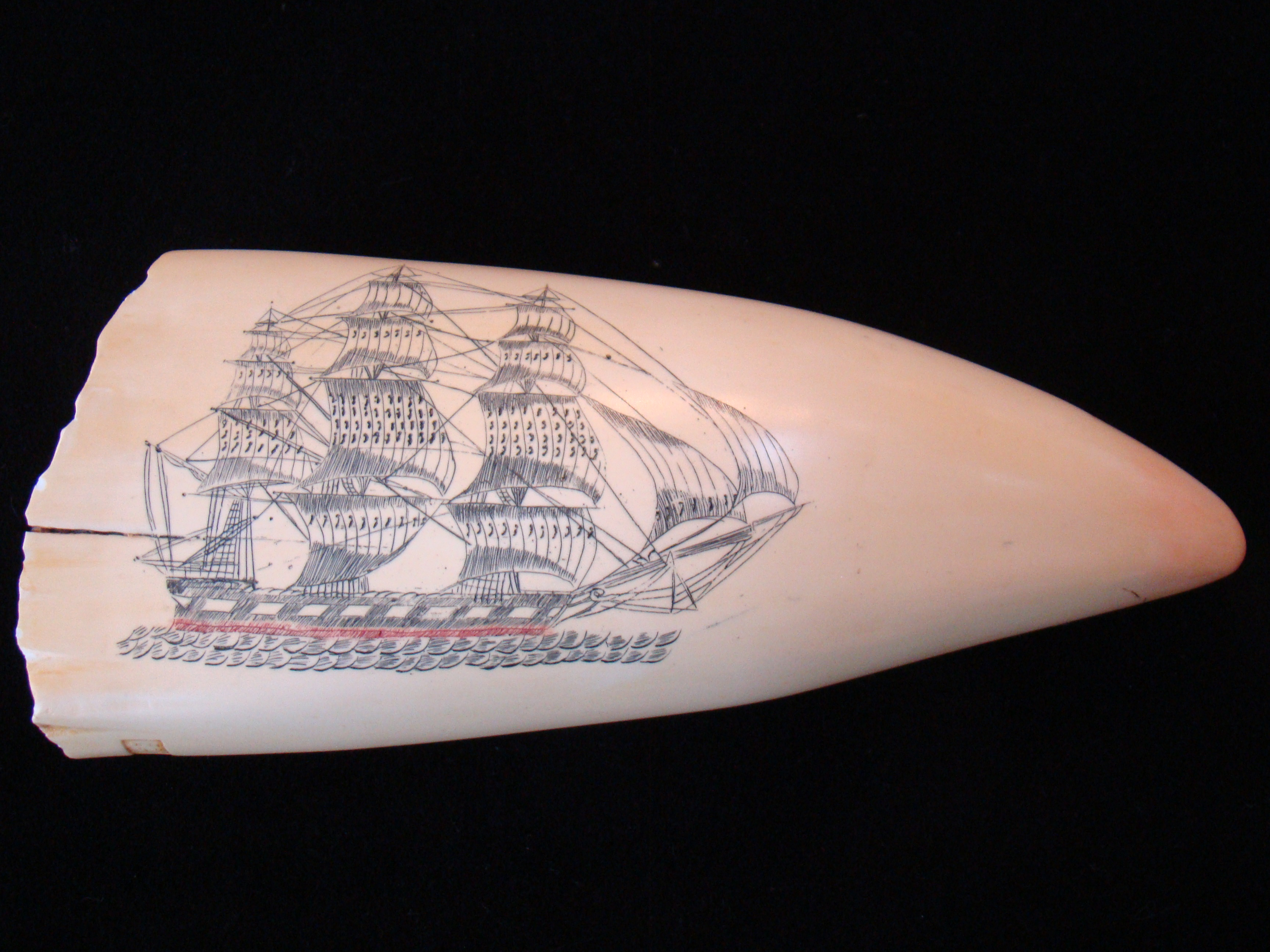 click to view detailed description of A very fine replica of a scrimshawed whales tooth in the JOHN F. KENNEDY collection
