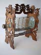 click to view detailed description of A fine 19th century Ship in a Bottle mounted in a carved fretwork stand circa 1880-1900