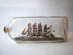 click to view detailed description of A highly detailed five-masted ship in a Bottle flying the American flag circa 1900