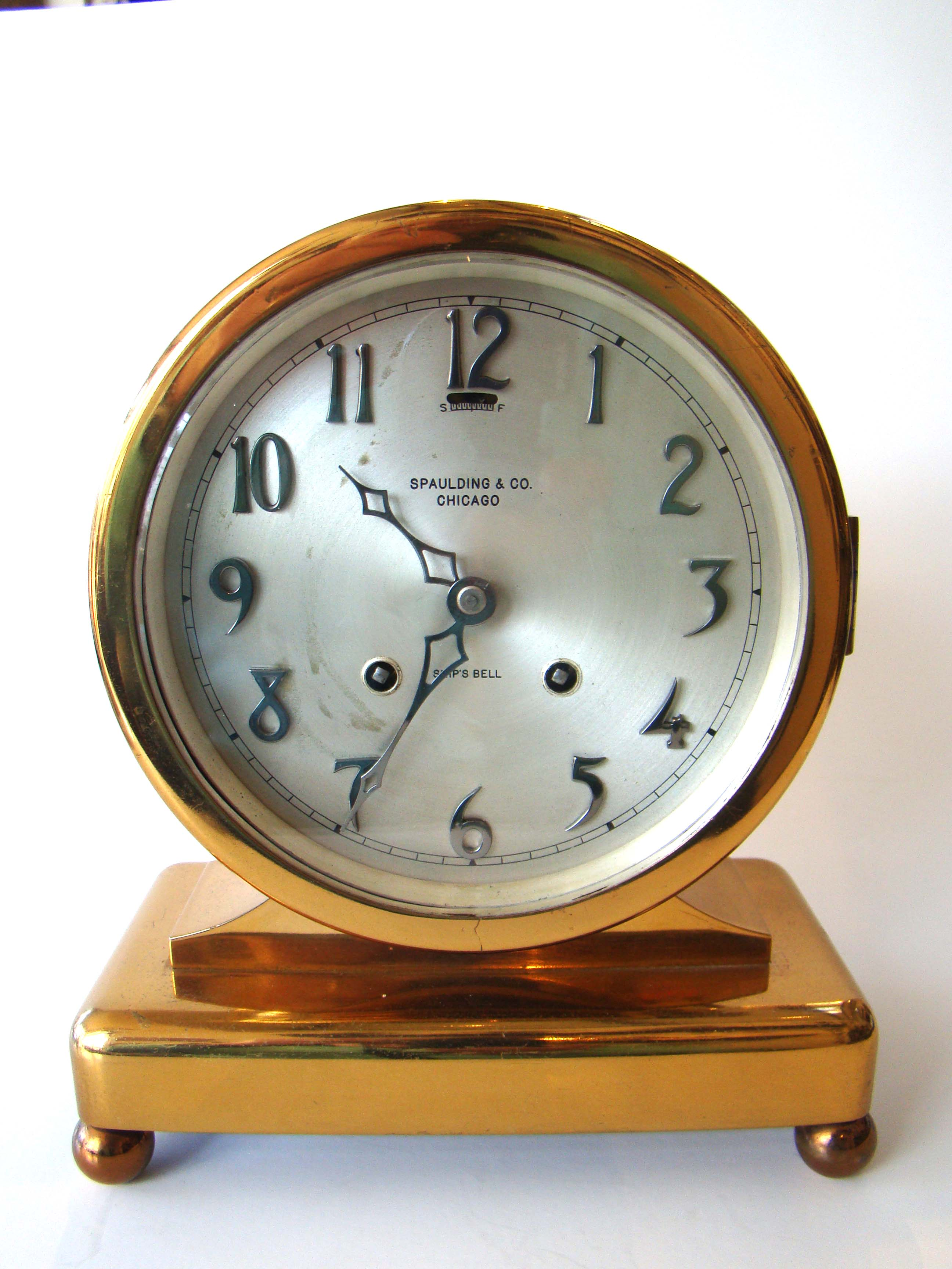 click to view detailed description of A fine vintage Chelsea Ship's Wheel clock circa 1922 with eight-day movement.
