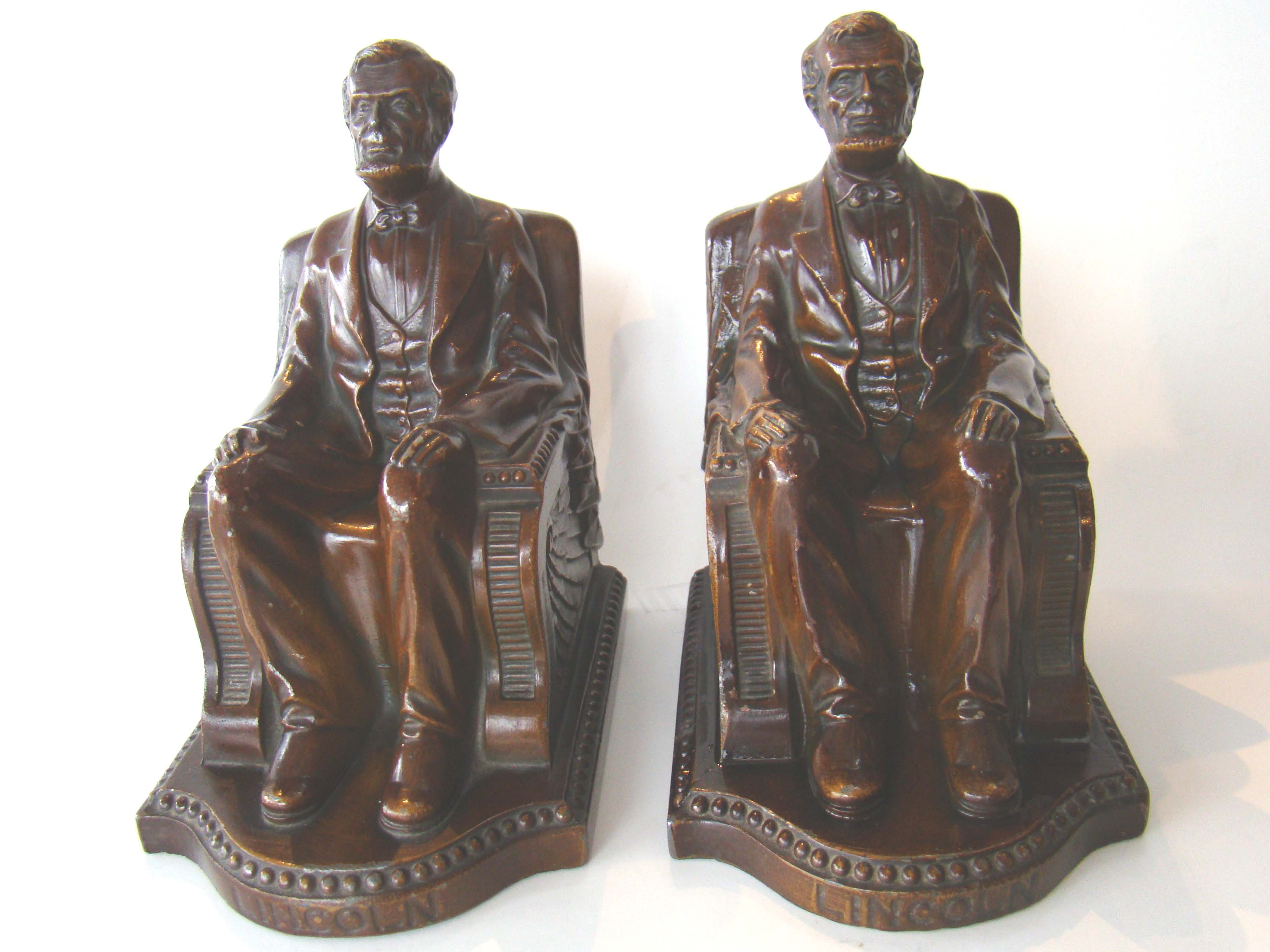click to view detailed description of A pair of 'Lincoln in the chair' bookends made by Nuart in 1924