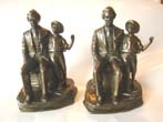 click to view detailed description of An extremely rare pair of vintage Mark Twain and Tom Sawyer bookends by Jennings Brothers circa 1936