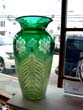 click to view detailed description of A gorgeous vintage emerald green cut glass art deco vase