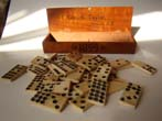 click to view detailed description of A set of 36 antique 19th century solid bone dominoes in a box inscribed