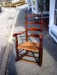 click to view detailed description of An 18th century New England Ladder back armchair circa 1760 converted to a rocker circa 1800