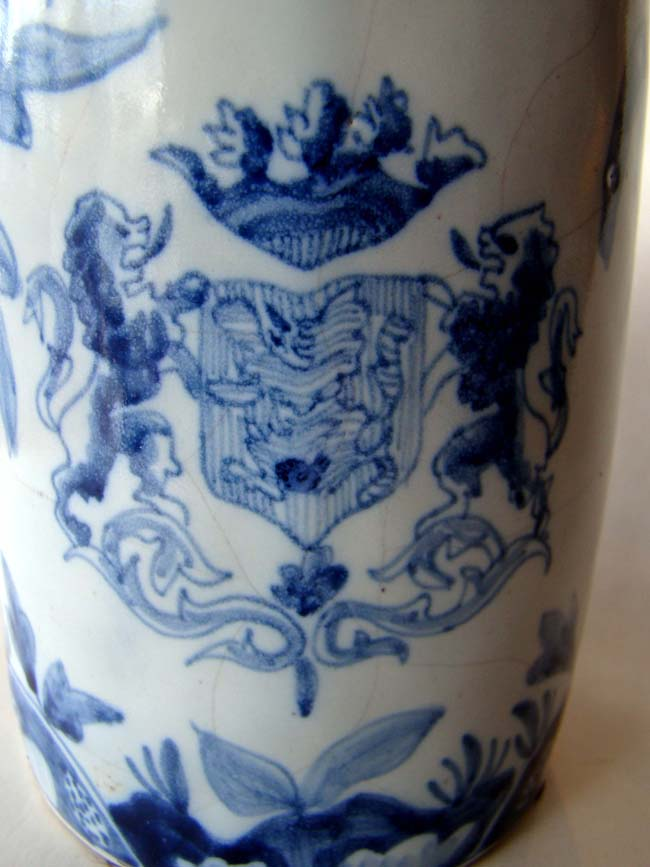 click to view detailed description of An 18th century Dutch delft mug featuring the Royal coat-of-arms of the Netherlands circa 1770