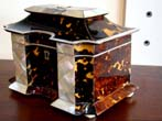 click to view detailed description of A Magnificent English Regency period Tortoiseshell, Mother-of-pearl and Ivory Tea Caddy Box circa 1815