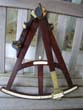 click to view detailed description of An exremely fine and rare Mahogany framed Mariners Octant dated June 23, 1777
