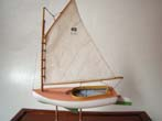 click to view detailed description of A charming 1:48 scale model of a Beetle Catboat circa 1921